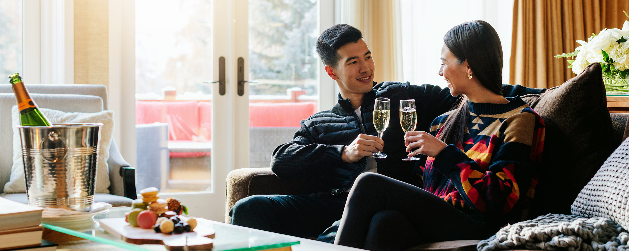 A couple enjoys champagne in their cabin