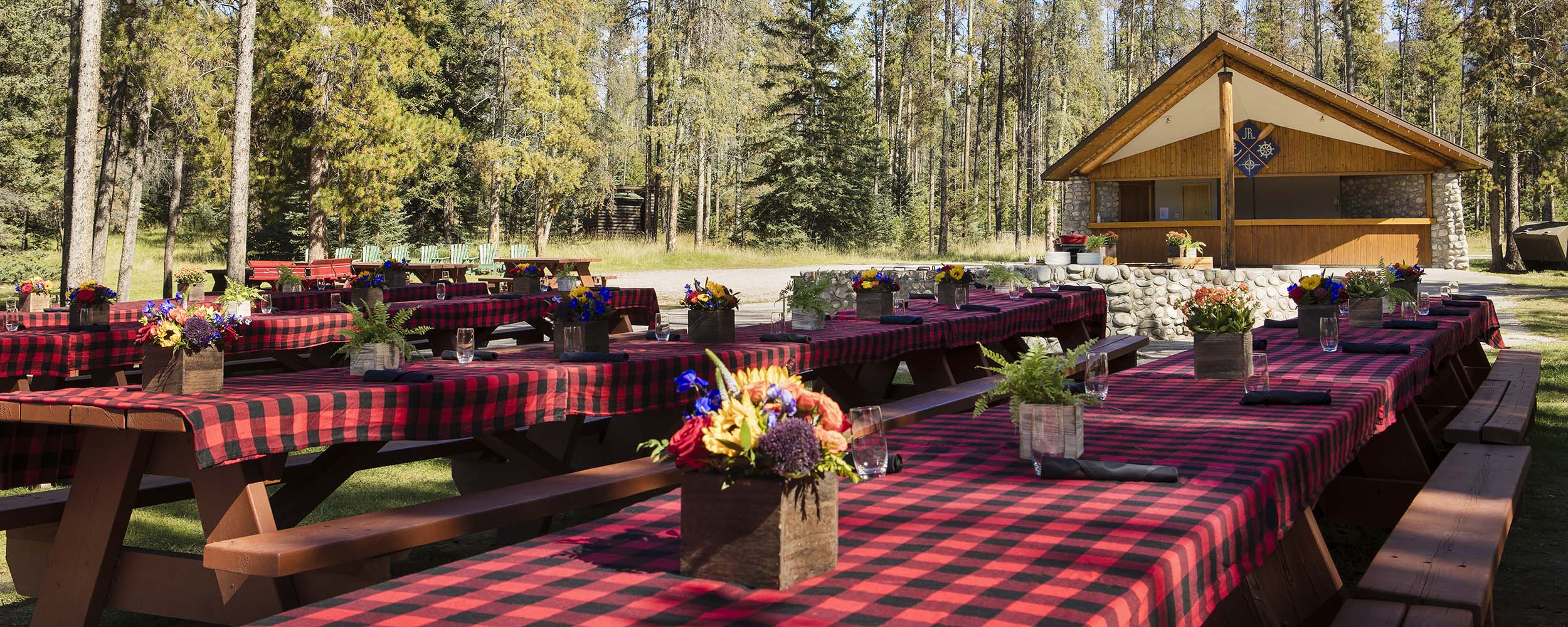 Picnic tables setup at Trefoil Lake for an outdoor BBQ
