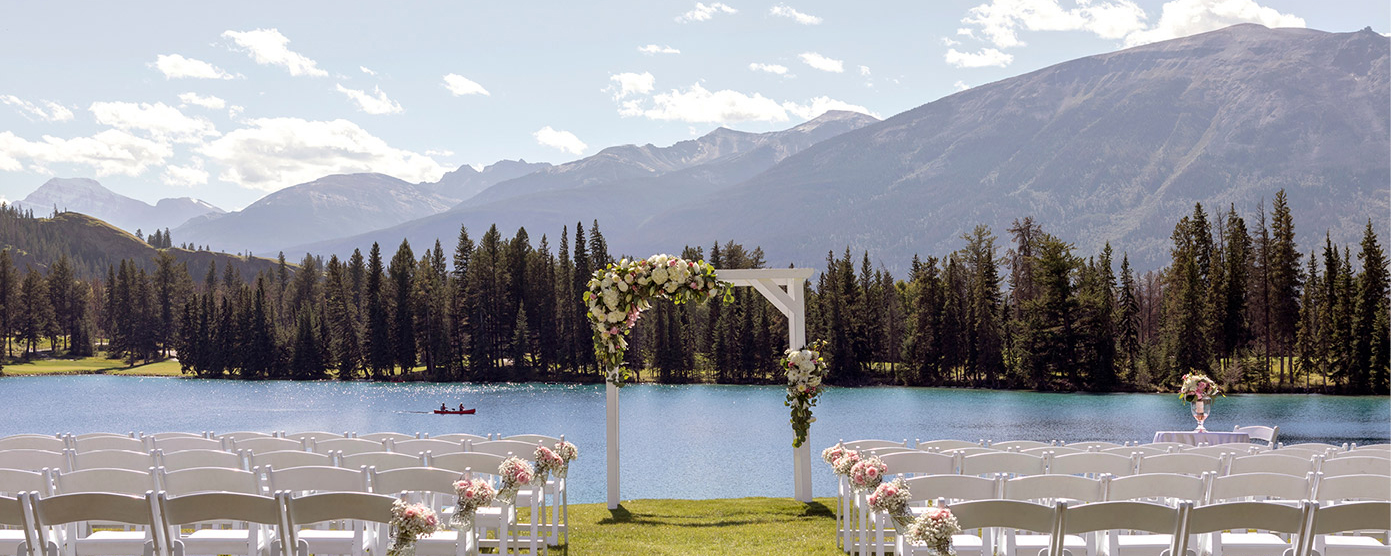 Wedding ceremony setup overlooking Lac Beauvert and the surrounding mountains