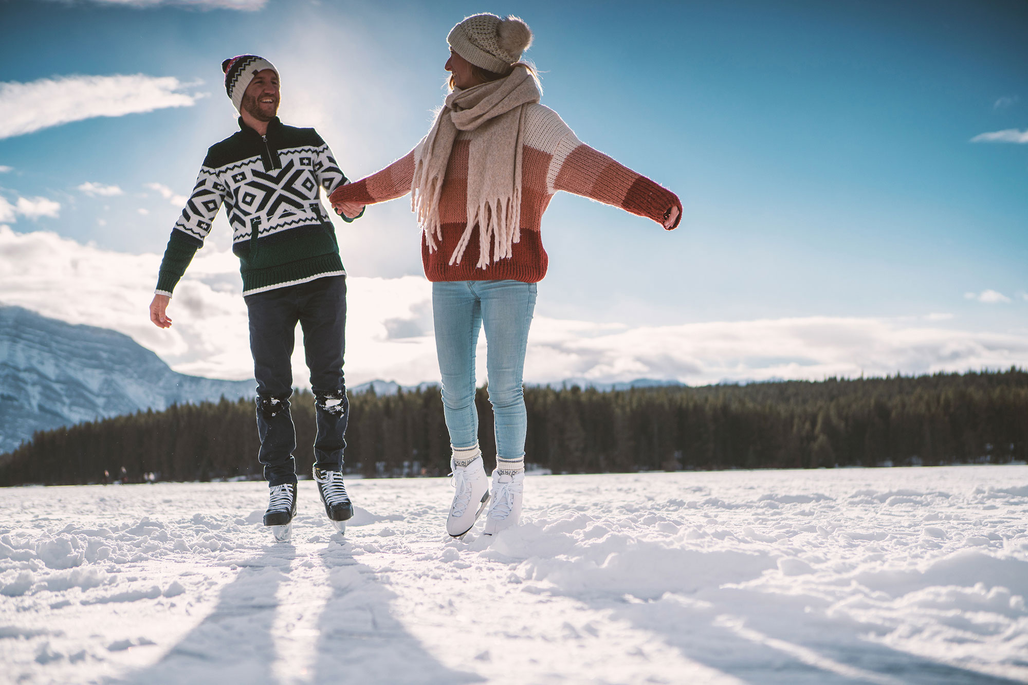 couple-skating-mountains-winter-things-to-do
