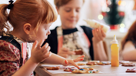 cute-little-girl-decorating-cookies-christmas