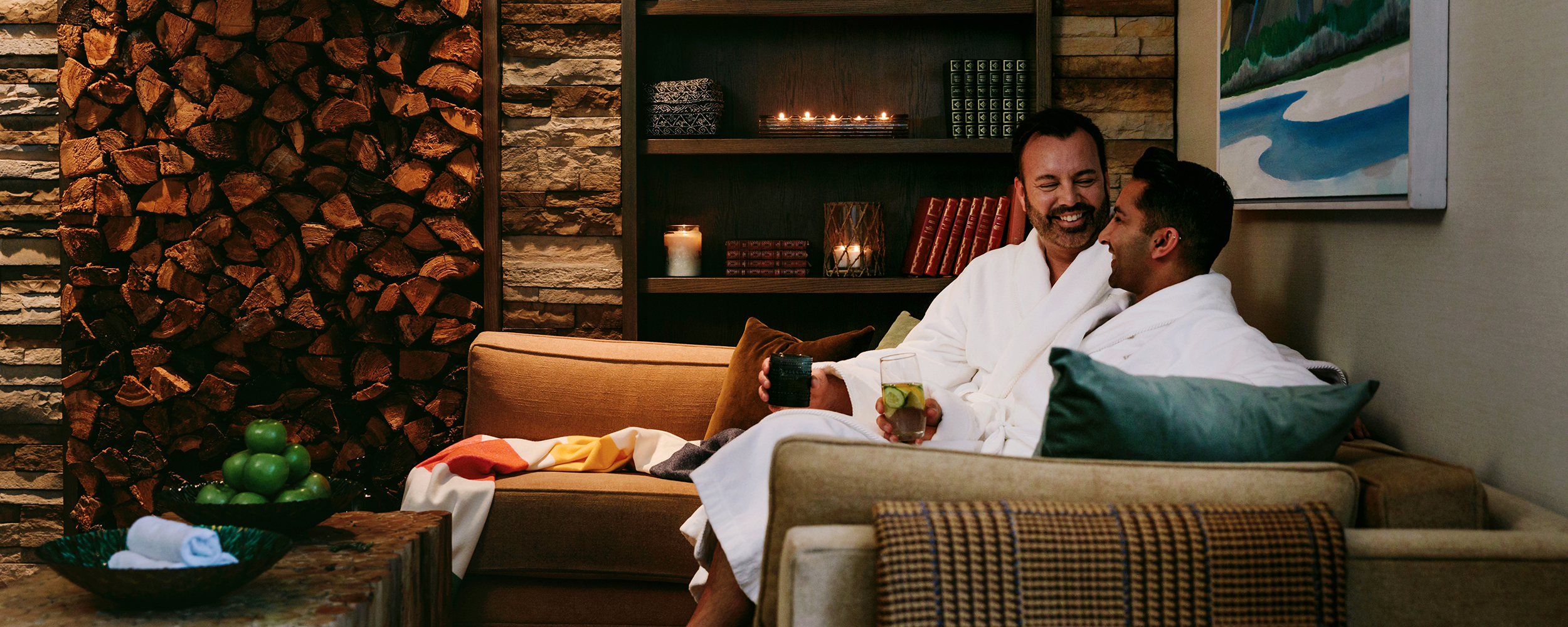 The Spa at Fairmont Jasper Park Lodge in Alberta - A couple sits in white robes in the Relaxation Lounge